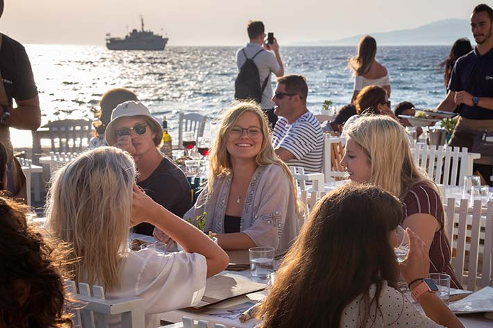 Students eating on the Docks of Mykonos