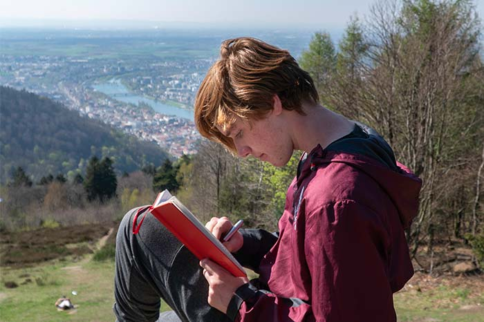 Student studying while overlooking Munich and the Rhine