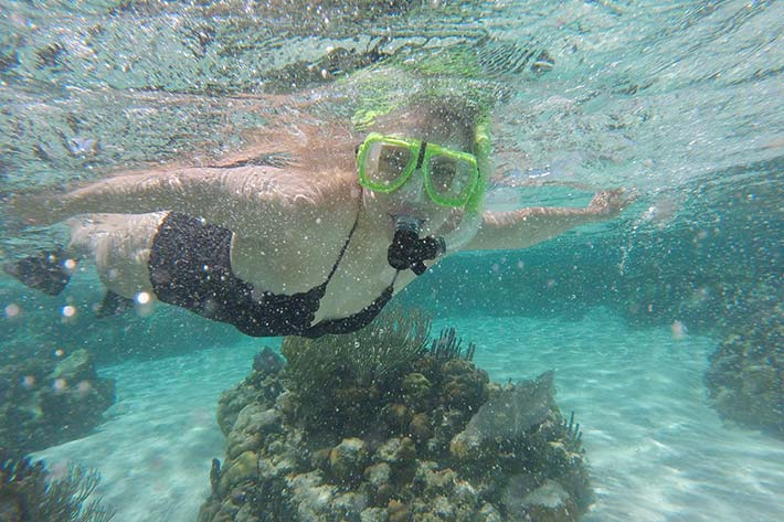 Student scuba diving in a reef