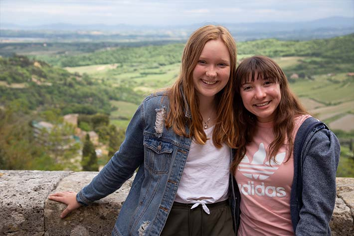 Students in front of the fields of Tuscany
